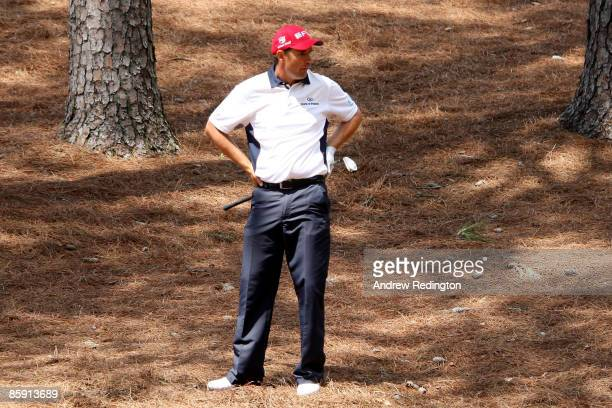 Padraig Harrington of Ireland prepares to play a shot from the pine needles on the second hole during the third round of the 2009 Masters Tournament...