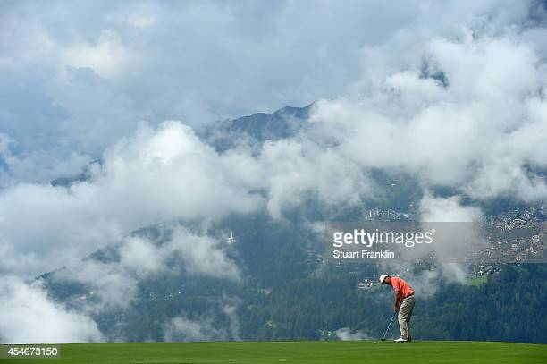 Padraig Harrington of Ireland putts during the second round of the Omega European Masters at CranssurSierre Golf Club on September 5 2014 in...