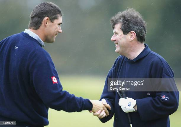 Padraig Harrington of Ireland, shakes the hand of playing partner J P McManus during the second round of the Dunhill Links Championship at Kingsbarns...