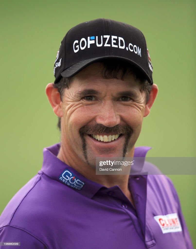 Padraig Harrington of Ireland shows off his 'Movember' moustache after he played his second shot at the par 5, 18th hole during the second round of the 2012 DP World Tour Championship on the Earth Course at Jumeirah Golf Estates on November 23, 2012 in Dubai, United Arab Emirates.