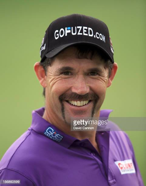 Padraig Harrington of Ireland shows off his 'Movember' moustache after he played his second shot at the par 5 18th hole during the second round of...