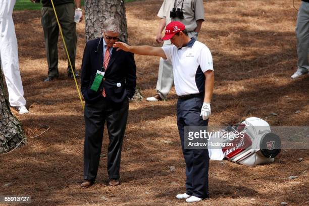 Padraig Harrington of Ireland takes a penalty drop from the pine needles on the second hole during the third round of the 2009 Masters Tournament at...
