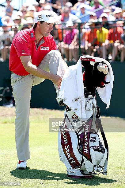 Padraig Harrington of Ireland ties his shoe on the first tee during Round One of the 94th PGA Championship at the Ocean Course on August 9 2012 in...