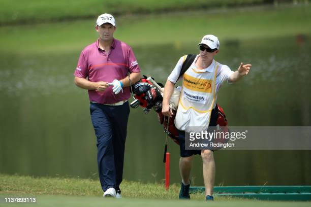 Padraig Harrington of Ireland walks on the 6th fairway with his caddie during Day Four of the Maybank Championship at Saujana Golf Country Club Palm...