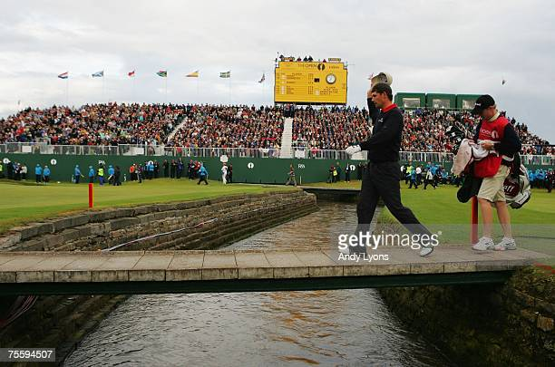 Padraig Harrington of Ireland walks with his caddie Ronan Flood on the final playoff hole during the final round of The 136th Open Championship at...