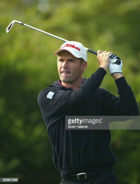 Padraig Harrington of Ireland watches a shot on the 11th tee during the second day of practice at the 104th U.S. Open at Shinnecock Hills Golf Club...