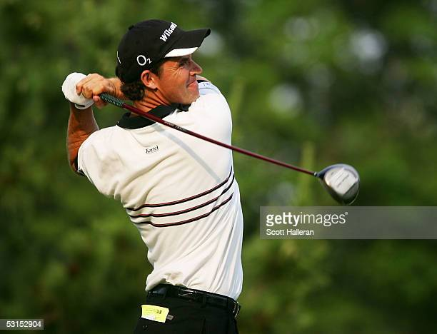 Padraig Harrington of Ireland watches his tee shot on the 18th hole en route to winning the Barclays Classic with a score of 10-under par on June 26,...