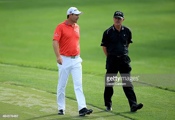 Padraig Harrington of Ireland with his coach Pete Cowen during the proam as a preview for The Honda Classic on the Champions Course at the PGA...