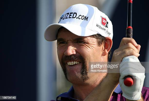Padraig Harrington of Ireland with his 'Momvember' mustache during the pro-am event prior to the DP World Tour Championship on the Earth Course at...