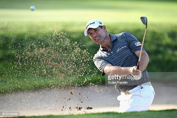 Padraig Harrington of Relublic of Ireland plays a bunker shot during the second round on day three of the Porsche European Open at Golf Resort Bad...