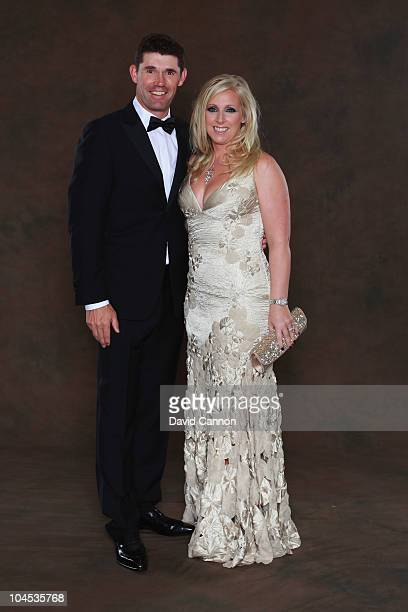 Padraig Harrington of the European Ryder Cup team poses with his wife Caroline prior to the 2010 Ryder Cup Dinner at the Celtic Manor Resort on...