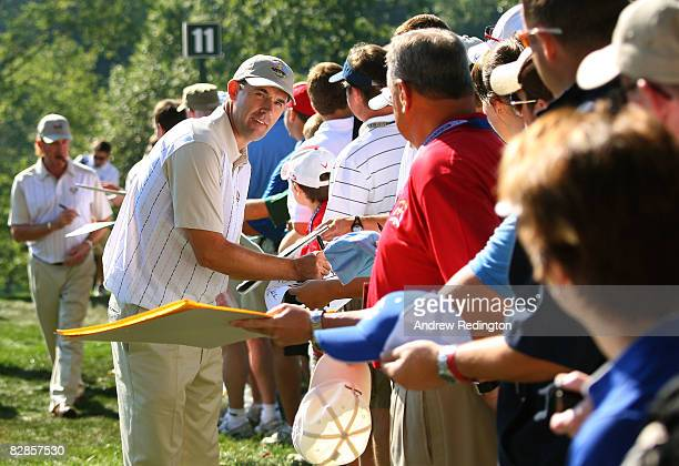 Padraig Harrington of the European team signs autographs for fans during a practice round prior to the 2008 Ryder Cup at Valhalla Golf Club on...
