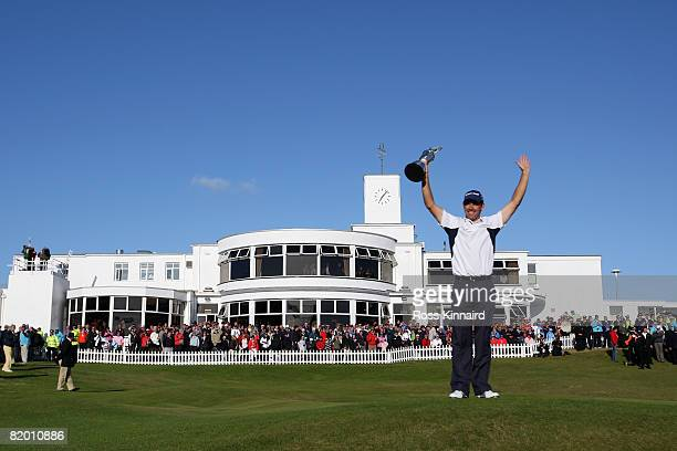 Padraig Harrington of the Republic of Ireland celebrates with the Claret Jug after winning by 4 strokes during the final round of the 137th Open...