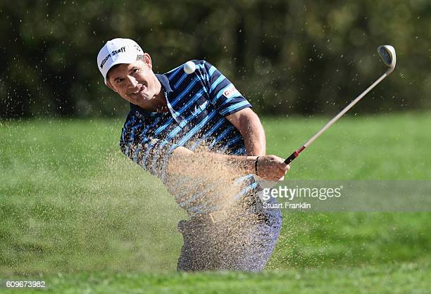 Padraig Harrington of the Republic of Ireland plays a bunker shot during day one of the Porsche European Open at Golf Resort Bad Griesbach on...