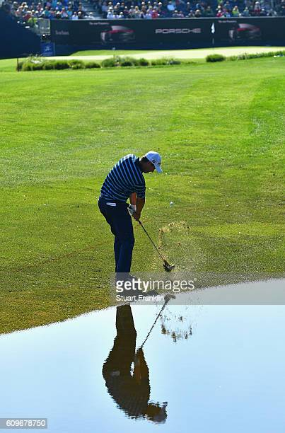 Padraig Harrington of the Republic of Ireland plays an iron shot during day one of the Porsche European Open at Golf Resort Bad Griesbach on...