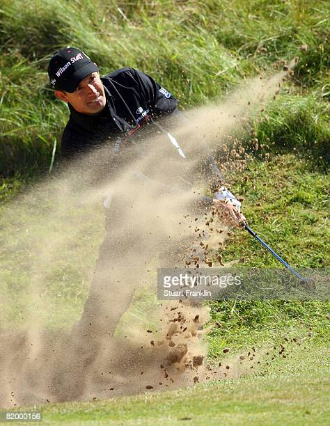 Padraig Harrington of the Republic of Ireland plays out of a bunker on the 2nd hole during the third round of the 137th Open Championship on July 19,...