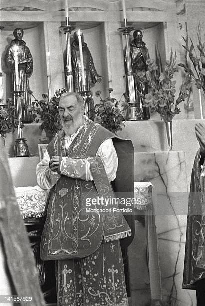 Padre Pio celebrating the mass with other priests in the church of Santa Maria delle Grazie San Giovanni Rotondo 1960s
