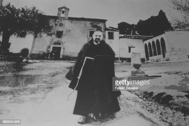 Padre Pio in front of the Capucin convent