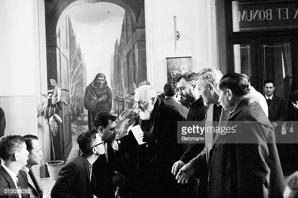 Padre Pio of Petralcina San Giovanni Rotondo Italy Padre Pio receives some of the faithful in a corridor leading from the Church of Santa Maria delle...