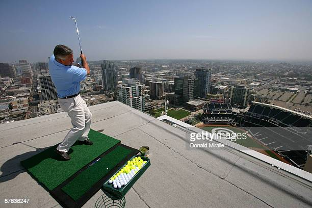 Padres GM Kevin Towers lands a practice swing off the roof of the Omni Hotel into a bullseye planted in rightcenter field at PETCO Park during the PF...