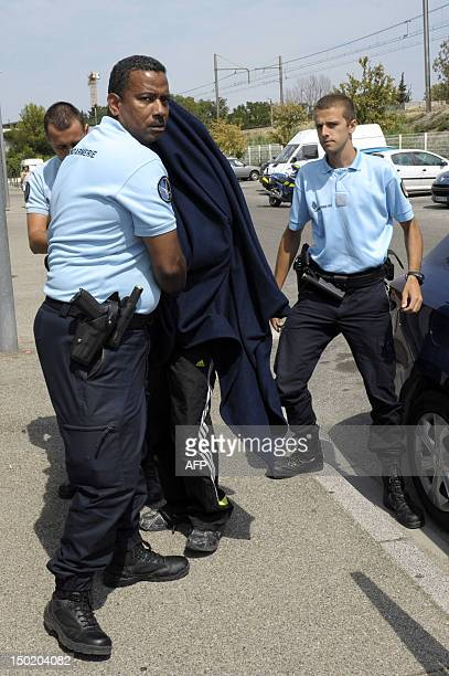 A paedophile who carried out serious sexual assaults on five girls holidaying on French campsites arrives at the Avignon courthouse on August 12...