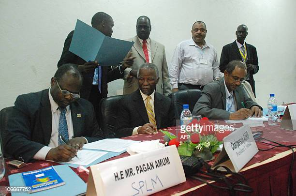 Pagan Amum signing on behalf of the Sudan's south ruling party the former rebel Sudan Peoples� Liberation Movement and Idris Abelgadir signing for...