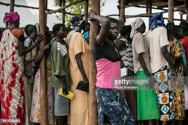 Pagarinya camp Hundreds of Sudanese refugees wait to get solar lamps and other badly needed assistance The Onward Struggle A refugee crisis in Uganda...