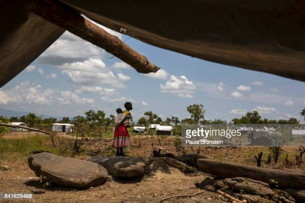 Pagarinya camp Refugees are seen walking back to their tent after a prayer service The Onward Struggle A refugee crisis in Uganda deepens as South...