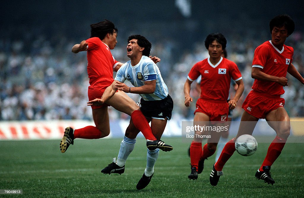 VOLUME 2. Page 13 picture 3. SPORT. Football. World Cup 1986 in Mexico City. Argentina (3) v South Korea (1). Argentina+s DIEGO MARADONA suffers injury after being badly fouled by South Korea+s JUNG MOO HUH. : News Photo