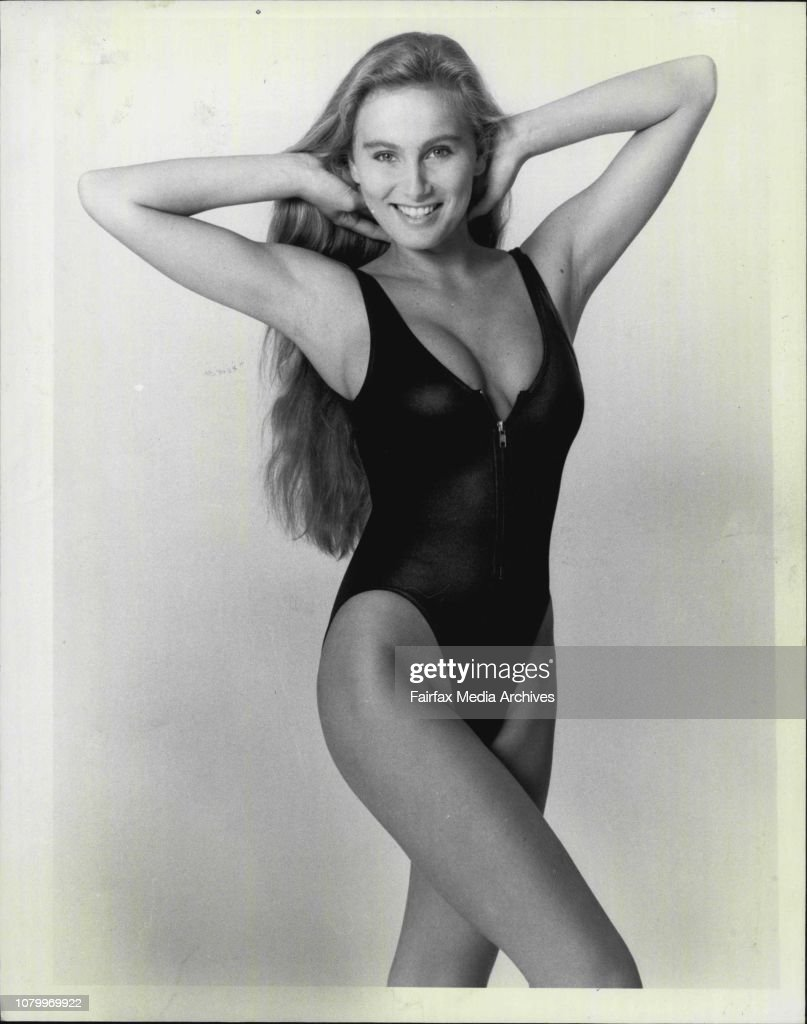 Page 3 Girl - Camilla.Here's a tip top zip top! And Camilla is oh-so-sleek in this hip-high cossie with the wearing neckline.The body moulding one-piece comes in stunning wet-look black.Get it for around $35 from Block's Ballet in the Strand Arcade. : News Photo