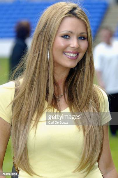 """Page 3 Girl Nicola McLean poses at the annual """"Music Industry Soccer Six"""" fundraising tournament on May 23, 2004 at the Madejski Stadium, in Reading,..."""