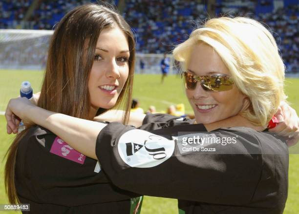 Page 3 girls Lucy Pinder and Jo Hicks pose at the annual Music Industry Soccer Six fundraising tournament on May 23 2004 at the Madejski Stadium in...