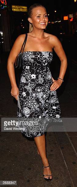 Page 3 model Ebony arrives for a party for Smart Flirt at The Rex Bar Grill September 24 2003 in London England