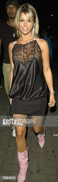 Page 3 Model Jakki Degg leaves an MTV party at the In Out Club August 12 2003 in London England