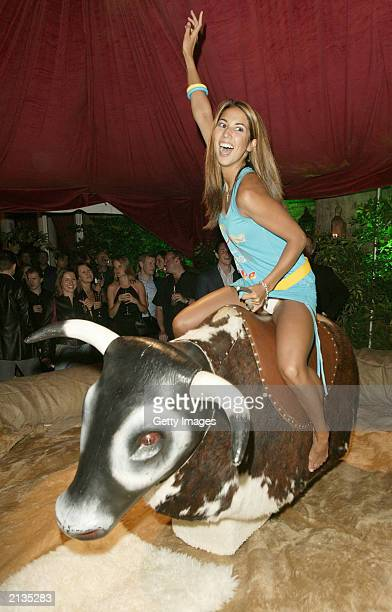 Page 3 Model Leilani rides a mechanical bull at the afterparty for the' film Charlies Angels 2 Full Throttle at the In and Out Club on July 1 2003 in...