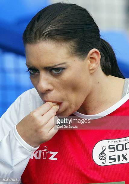 Page 3 Model Lindsey Dawn McKenzie eats an orange at annual Music Industry Soccer Six fundraising tournament at Everton's Goodison Park on May 9 2004...