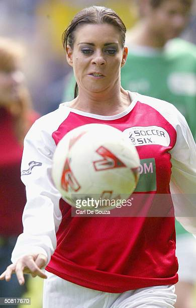 """Page 3 Model Lindsey Dawn McKenzie plays at annual """"Music Industry Soccer Six"""" fundraising tournament at Everton's Goodison Park on May 9, 2004 in..."""