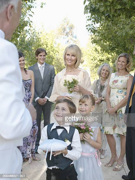 page boy (7-9) and flower girl (6-8) at wedding - ring bearer stock pictures, royalty-free photos & images