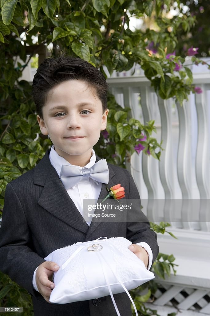 Page boy holding wedding rings : Stock Photo