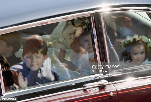 Page boy Jasper Dyer and bridesmaids Florence van Cutsem and Princess Charlotte of Cambridge attend the wedding of Prince Harry to Ms Meghan Markle...