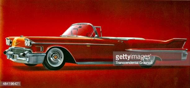 A page from a promotional folder for the Cadillac automobile is issued by General Motors in Detroit Michigan in 1958 The red sedan has modified fins...