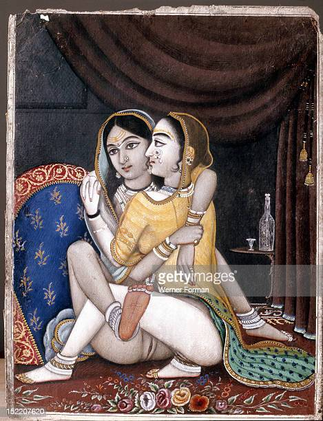 A page from an erotic album painting Two women embrace each other against a plush background of sumptious curtains and richly woven carpet India...