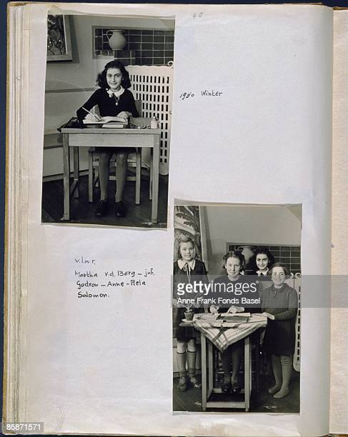 A page from Anne Frank's photo album containing two school snapshots Amsterdam Holland winter 1940 Anne's friend Martha van den Berg is also pictured