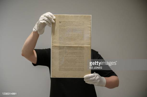 Page of the first printing of the United States Constitution is displayed at the offices of Sotheby's auction house in New York on September 17,...