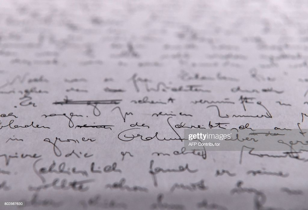 A page of the original manuscript of Franz Kafka's 'The Trial' is on display at the exhibition 'Franz Kafka - The entire Trial' at Berlin's Martin Gropius Bau museum on June 28, 2017. The unfinished novel, written by Kafka between August 1914 and January 1915 in Berlin, was published posthumously by his friend Max Brod in 1925. / AFP PHOTO / John MACDOUGALL