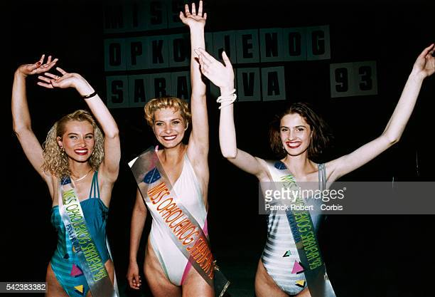 Pageant winner Inela Nogic and the two runners-up, wave to the audience during the 1993 Miss Sarajevo Pageant which was held in a movie theater in...