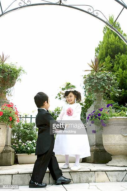 Pageboy and flower girl in the garden