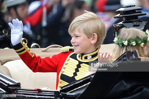 Pageboy Master Tom Pettifer makes the journey by carriage procession to Buckingham Palace following the marriage of Prince William Duke of Cambridge...