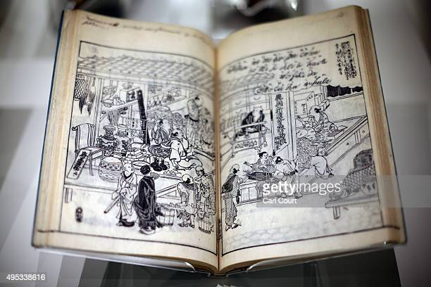 Pages from a woodblockprinted book by Takehara Shunchosai titled 'Hikida's Foreign Goods Shop' are pictured during a press preview for the Victoria...