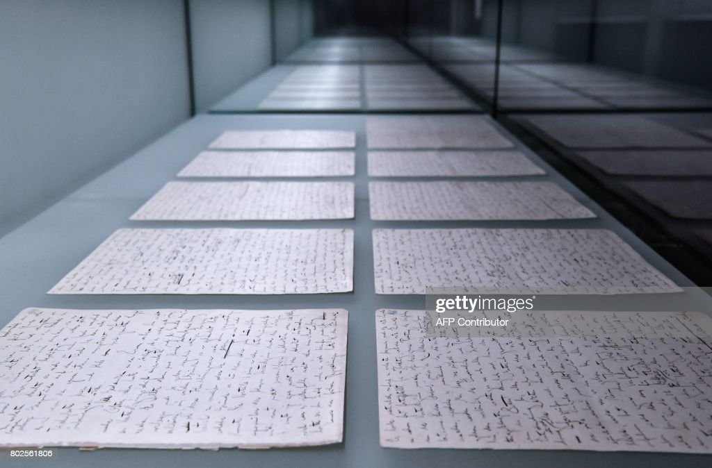 Pages from the original manuscript of Franz Kafka's 'The Trial' are on display at the exhibition 'Franz Kafka - The entire Trial' at Berlin's Martin Gropius Bau museum on June 28, 2017. The unfinished novel, written by Kafka between August 1914 and January 1915 in Berlin, was published posthumously by his friend Max Brod in 1925. / AFP PHOTO / John MACDOUGALL